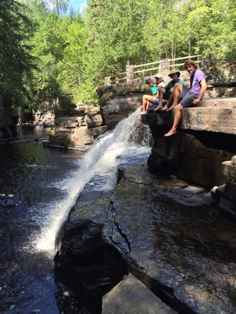 8 Awesome Waterfalls In Michigan Where You Can Swim This