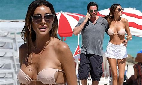 Laura Zilli flaunts her cleavage as she hits Miami beach