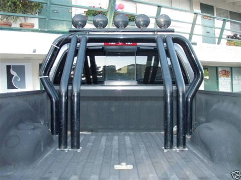 Go Rhino Bed Bars with KC Daylighters for Sale