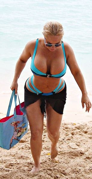 Ice-T checks out Coco Austin's curves in blue bikini on